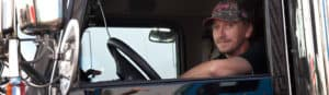 Trucker in Cab of Truck